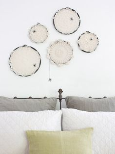 Use crochet doilies to create these faux spiderweb decorations.