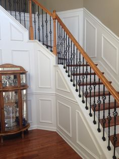 Staircase and Foyer Renovation.  Added wainscot paneling and replaced stair treads and balusters.