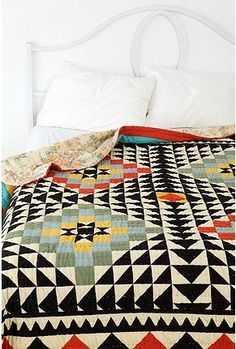 Love the black triangles in this quilt