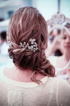 I love the side-swept hair with accessories