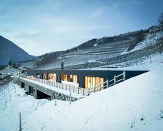 an earth-bermed home in a winter scene