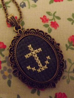 Gorgeous Cross stitched pendant by Painted Lady Craft Creations. £12.00