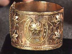 Gypsy Jewelry:  A Gypsy bracelet. Gypsy jewelry often incorporates twisted wirework, known as filigree, dangling hearts, stars, and raised flowers. Gypsies were also fond of the horseshoe shape, commonly used in the popular cuff bracelets.
