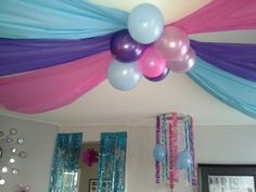 $ store tablecloths on the ceiling and hula hoop chandelier I used with different ribbons and balloons as streamers