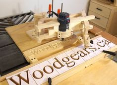 Create a wood pantographs to translate large stencils into a routed wooden sign. Very slick.