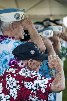 """121207-N-XD424-066 PEARL HARBOR (Dec. 07, 2012) Pearl Harbor survivors salute during the 71st Anniversary Pearl Harbor Day Commemoration. More than 2000 guests, including Pearl Harbor survivors and other veterans, attended the National Park Service and U.S. Navy-hosted joint memorial ceremony at the World War II Valor in the Pacific National Monument. This year's theme focused on """"Coming of Age – From Innocence to Valor."""" (Photo by Mass Communication Specialist 3rd Class Dustin W. Sisco)"""