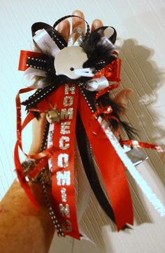 homecoming mum ring..I like this, but probably with shorter ribbons.