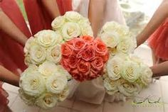 white bridesmaid bouquets and coral bridal bouquet