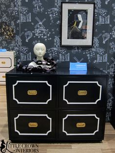 This #campaign #dresser makes a huge style statement as a changing table in a #Black #nursery.