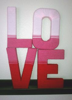 Wrap letters in yarn.
