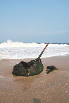 Tank buried in sand. Remnants of the Angolan Civil War. Soyo, Zaire Province, Angola.