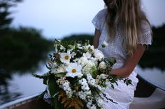 white wildflower inspired wedding bouquet with cosmos and chamomile flowers, ferns and hosta leaves | floral design: Amy Merrick