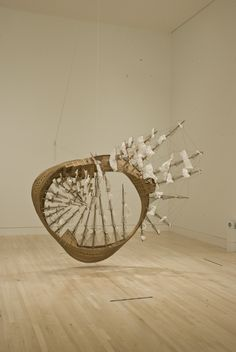 Möbius Ship by Tim Hawkinson.  Made of wood, plastic, Plexiglass, rope, staples, string, twist ties, and glue