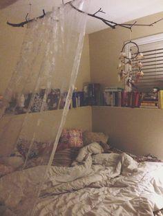 My Sanctuary. Boho bedroom, dreamcatcher, tree branch, half canopy, pillows, books everywhere.