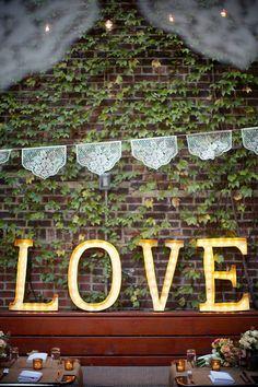#signs, #love    Photography: Weddings By Two - weddingsbytwo.com    Read More: http://www.stylemepretty.com/2014/01/15/brooklyn-bridge-park-wedding/