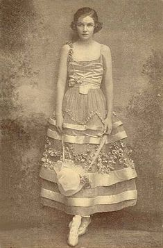 Irene Castle, in a dress by Lucile, bobbed her hair in 1914 well before it became popular in the 20's.