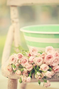 How adorably vintage does this look? Rusty chair, mint green, and pink rosebuds. So me!