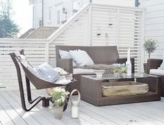 Colorbond white screen and decking boards painted white and nice relaxing area. #screen #colorbond #deck #white
