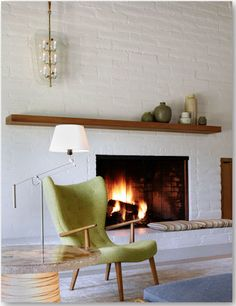 if this was my space, I'd have the chair facing that fireplace