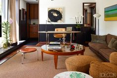 the floor lamp is by Alvar Aalto, the table lamp is by Luceplan, and the artworks are by Richard Serra (left) and Kenneth Noland