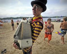 Davey the Clown plays the accordion during family fun day at the town landing in Pembroke Saturday, Aug. 11. Amelia Kunhardt/The Patriot Ledger