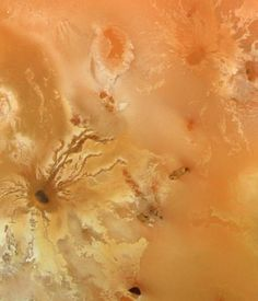 Io - volanic craters - by Voyager 1 (128.000 km away)