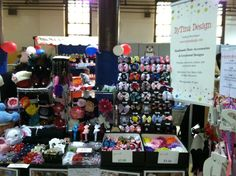 Bytinadesign.com craft show display of hair bows, hats, headbands, hairbow holders, crochet items and more!