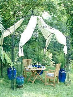 This elegant outdoor room was put together in just a few hours and without spending a lot of money. An alfresco dining spot, is arranged under a metal gazebo. Snap-on weather-resistant fabric panels shade the space from sunlight.