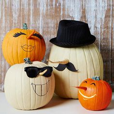 Delight fall guests with these cute pumpkins with faces! More creative pumpkin ideas: http://www.bhg.com/halloween/pumpkin-carving/cool-halloween-pumpkins/