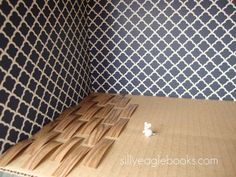 dollhouse wooden floor and wallpaper by Silly Eagle Books, via Flickr