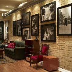 Wonderful, dramatic family picture wall with oversized family photos and great lighting. I would try this out if we ever had a classy looking basement..