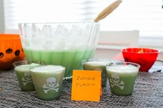 In a punch bowl add 2 cups of Citrus Soda, 2 cups of lime soda, 4 cups of Ginger Ale and 1 gallon of lime sorbet. Stir for a delicious Zombie Punch.
