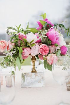 Pretty pink centerpiece | Read More: http://www.stylemepretty.com/2014/06/12/romantic-wedding-at-walnut-hill-farms/ | Photography: The Reason Photography - thereasonilove.com/