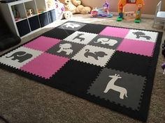 This children's playroom uses a custom set of SoftTiles Safari Animals in Gray and White with some solid SoftTiles in Pink and Black. http://www.softtiles.com/index.php?option=com_virtuemart&Itemid=138