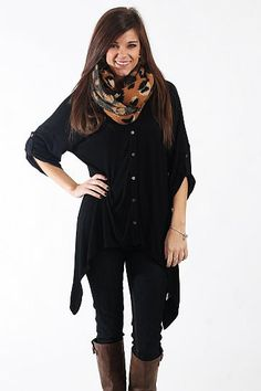 "Easy For You Top, Black $38.00  This top is super comfy! This piece has an amazing asymmetrical neckline, buttons up the front, tabbed sleeves and a v neck. But our favorite part is the incredibly soft and cozy material! Put this on with jeans and boots for a chic look that'll be comfy all day long.   Fits true to size. Miranda is wearing a small.   From shoulder to hem:  Small - 26""  Medium - 27""  Large - 28"""