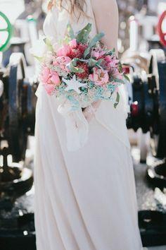 tropical wedding bouquet, photo by IglooPhoto http://ruffledblog.com/wedding-inspiration-on-an-italian-sailing-ship #weddingbouquet #flowers #bouquets