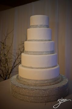 white wedding cake with bling #wedding #cake (would be beautiful with blue green purple rhinestones)