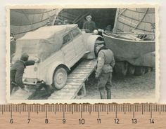 Kubelwagen being loaded onto a Messerschmidt 323, the largest land-based aircraft of the war.