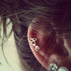 cursive love earring peircings-and-tattoos