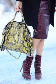 Stella McCartney Falabella bag, Metallic leather skirt and Dior booties on thefashionfuse.com