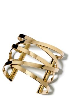 Shiny and gorgeous! This wide cuff statement piece is perfect for completing an outfit.