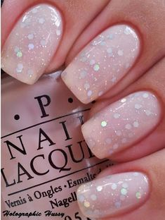 "OPI Barre"""""" My Soul which is a pale, rosy pink jelly. Then I added a coat of NYX Holographic Glitter"""""