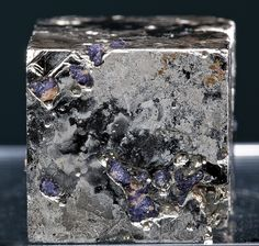 mineralists:  Pyrite cube with inclusions of purple Fluorite from Climax Mine, Colorado