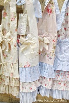 Gorgeous aprons--I'd wear them over jeans and a t-shirt :)