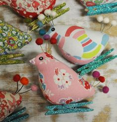 Cute sewn birdie mounted on a glittery clothespin for display on Christmas tree or any decor...