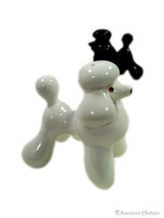 "New Black White Poodle Dog Salt and Pepper Shakers Set by American Chateau. $9.24. Poodle Design. Made from Ceramic. Handpainted Black & White. Salt & Pepper Shaker Set. Make your seasonings that much sweeter with this handsome duo of salt & pepper shakers. Beautiful poodles made of ceramic. Approximate Dimensions: 3 1/4"" H x 3"" L x 2"" W."