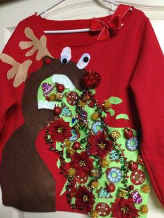 Sweatshirt I altered-made for an ugly sweater pub crawl that's coming up soon with friends:) I found the idea on You Tube and tweaked their idea a bit. I love how the finished product turned out!!