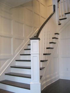 traditional staircase, newel post with cap stained to same shade as banister