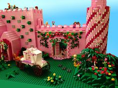 FrenzFantasyCastle by Pink Pterodactyl.  Love the round tower and the entrance with the flowery vines :)