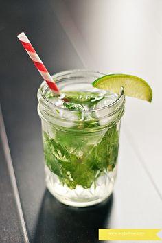 8 fresh mint leaves  1 1/2 Tbs. simple syrup   1 Tbs. fresh lime juice  Crush ice as needed  2 oz light rum  2 oz club soda  1 lime wedge  Serve 1